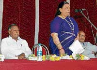 Legislative Council member Vimala Gowda speaking at the annual day celebration of the Sabarmati High School in Suguturu in Kolar taluk on Monday. M V Chouda Reddy, V Venkatamuniyappa and Prof Gajendragada are also seen. dh photo