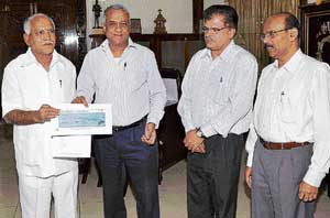 charity: The Printers (Mysore) Pvt Ltd Joint Managing Director and Deccan Herald Editor K N Tilak Kumar handing over the demand draft for Rs 2.03 crore to Chief Minister B S Yeddyurappa towards the CM's Calamity Relief Fund at Vidhana Soudha In Bangalore on Tuesday. The fund was collected from the readers of Deccan Herald & Prajavani. Deccan Herald Associate Editor  K Subrahmanya and Prajavani Associate Editor Padmaraj Dandavati are seen.  dh photo