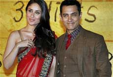 Bollywood actor Aamir Khan along with actress Kareena Kapoor at the premiere of '3 Idiots' in Mumbai on Wednesday night. PTI Photo