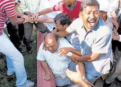 Up in arms: TDP legislator N Janardhan Reddy being beaten up by pro-Telangana activists during a protest in Hyderabad on Thursday. PTI