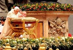 Pope recovers from fall to lead midnight Christmas Mass