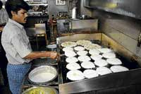 Onion dosas being prepared. DH photos by Dinesh S K