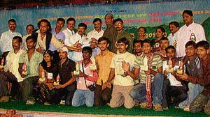 The winners of various competitions at the State-level  Yuvajanotsava with the Minister for Youth Affairs and Sports Goolihatti D Shekhar in Tarikere on Friday.  dh photo