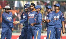 India's Virender Sehwag, left, congratulates Harbhajan Singh, third left, on taking the wicket of Sri Lanka's Sanath Jayasuriya, unseen, as other teammates look on during their fifth and final one-day international cricket match in New Delhi. PTI