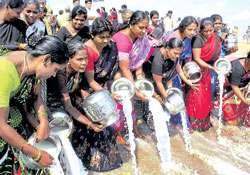 A group of women pouring milk in the sea at Marina beach in the memory of tsunami victims in Chennai on Saturday. PTI