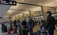 Travelers to the United States face stricter security measures . AP