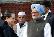 Congress President Sonia Gandhi with Prime Minister Manmohan Singh during the 125th Foundation Day function of the party in New Delhi on Monday. PTI