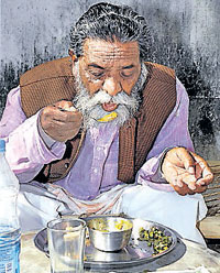 JMM chief Shibu Soren enjoys his lunch at his residence in Ranchi on Sunday. PTI