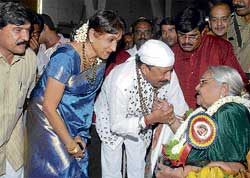 Vishnuvardhan and Bharati greeting his teacher in Shishuvihara (kindergarten), N Padmavathamma at a felicitation programme in Mysore last year. DH file photo