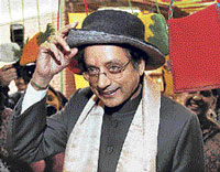 MoS for External Affairs Shashi Tharoor tries a cap at Nepal stall at the Annual Dastkari Haat Samiti Festival in New Delhi on Wednesay. PTI