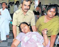 IN PAIN: Slain forest brigand Veerappan's wife Muthulakshmi being wheeled into K R Hospital in Mysore on Thursday. DH Photo