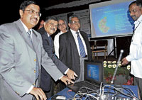 RBI Regional Director B Srinivas (left) inaugurating SBM's new ATMs in Bangalore on Friday. SBM MD Dilip Mavinkurve (centre) & Justice Rajendra Babu are with him. DH Photo