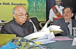 Governor H R Bhardwaj releasing books on Vijayanagara Empire in Bangalore on Monday.  dh photo