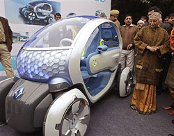 Delhi Chief Minister Sheila Dikshit looks at a Renault Twizy Z.E. concept car during a preview ahead of International Auto Expo, at her residence in New Delhi on Monday. Auto Expo is scheduled from Jan. 5 to 11. AP