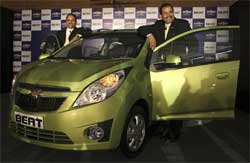 General Motors India Vice President P. Balendran, right, stands next to a Chevrolet Beat during it launch in Mumbai, Monday. AP