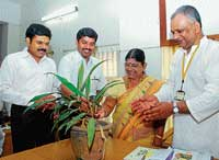 Deputy Commissioner V Ponnuraj and Deputy Mayor Rajani Dugganna inaugurating a workshop on solid waste management by watering a plant in Mangalore on Tuesday. dh photo