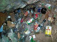 Liquor bottles thrown near Irpu falls at Gonikoppa. dh photo