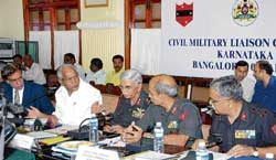 Chief Minister B S Yeddyurappa sharing a word with Southern Command Major General K N Mirji, K and K Sub Area Commander Brigadier P S Ravindranath and other officials at Civil Military Liaison conference at Vidhana Soudha on Wednesday. Chief Secretary S V Ranganath is also seen. dh Photo