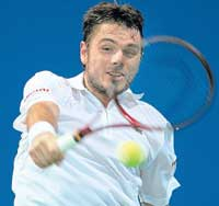 Fluid elegance: Switzerland's Stanislas Wawrinka rips a backhand return during his  straight-set victory over Michael Russel in the Chennai Open on Thursday. AFP