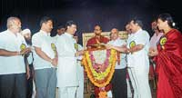 District-in-Charge Minister J Krishna Palemar inaugurating the awareness programme organised for minority at Town Hall in Mangalore on Thursday. DH photo