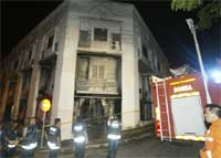 Fire rescue personal inspect the damage after unidentified attackers set fire to a church in Malaysia, early Friday. AP
