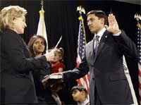 Hillary Rodham Clinton, left, administers the oath of office to U.S. Agency for International Development (USAID) Administrator Rajiv Shah on Thursday during a ceremony in Washington. AP