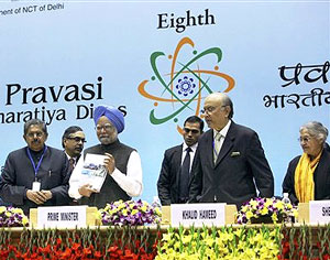 Prime Minister Manmohan Singh releases the book 'Investment Tool Kit for Global Indians' as chief guest Lord Khalid Hameed of Hampstead, Minister of Overseas Indian Affairs Vayalar Ravi and Delhi Chief Minister Sheila Dikshit look on, during the inaugural session of 8th Pravasi Bharatiya Divas - 2010 at Vigyan Bhawan in New Delhi on Friday. PTI