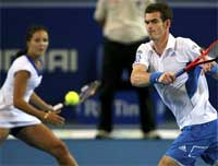 Britain's Andy Murray, right, and Laura Robson play a return to Russia's Elena Dementieva and Igor Andreev during their doubles match at the Hopman Cup tennis tournament in Perth, Australia on Friday. AP