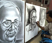 An artist gives final touches to a pencil sketch of former Chief Minister of West Bengal Jyoti Basu, in Kolkata on Friday. PTI