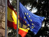 The Spanish flag and the European Union flag fly in front of the Moncloa palace in Madrid on Friday during a meeting of European officials. AFP