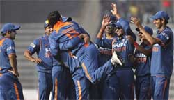 Indian players lift teammate Yuvraj Singh, back to camera, to celebrate after he dismissed Bangladesh's Raqibul Hasan (not in pix), during the sixth ODI cricket match of the tri-series in Dhaka. AP