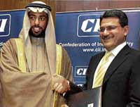 Bharti Airtel CEO Manoj Kohli & Sheikh Mohammad Nahayan-Al-Nahayan of Dhabi Group exchanging MoU, in New Delhi. PTI