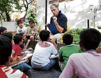 Hooked: Michael Panckridge with kids at a discussion on books organised by Hippocampus Book Council and the Australia-India Council PIC / ADITI KULOTHUNGAN