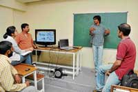 Rabi explaining the process of film-making to the students.