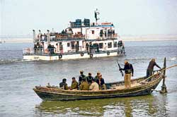 Securitymen keep vigil near a floating restaurant in the river Ganga where Bihar Chief Minister Nitish Kumar held a cabinet meeting in Patna on Thursday. Pti