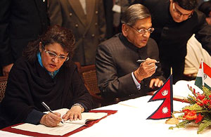 Foreign Minister S.M. Krishna(R) and Nepal's Deputy Prime Minister and Foreign Minister Sujata Koirala sign a memorandum of understanding in Katmandu, Nepal on Friday. AP