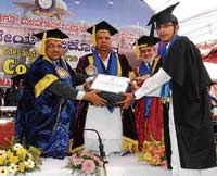 M B Chetan receiving medals at the third convocation of Karnataka Veterinary Animal and Fisheries Sciences University in Bidar on Sunday. DH Photo