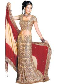 A heavily embroidered lehenga comes with minimal jewellery
