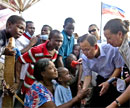 UN chief Ban Ki Moon speaks with displaced Haitians during his trip to Haiti. AFP