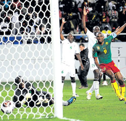 Cameroon skipper Samuel Eto'o (right) scores against Zambia during their African Nations Cup match on Sunday. AFP