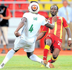 Burkina Faso's Hamadou Tall and Ghana's Haminu Dramani (right) battle for possession in the African Nations Cup on Wednesday. AFP