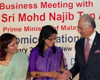 Malaysian Prime Minister Mohd Najib Tun Abdul Razak with HSBC CEO Naina Lal Kidwai and ASSOCHAM President Swati Piramal at a Business Meeting on 'Malaysia-India Economic Relations- The Way Forward' in New Delhi on Wednesday. PTI