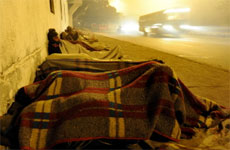In a picture taken on January 7, 2010 Indian homeless people sleep on a pavement in New Delhi. AFP