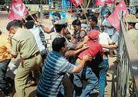 road to justice Police arresting CPM activists who were picketing the Deputy Commissioner's office in Mangalore on Thursday demanding 35 kg rice to poor families every month at Rs 2 per kg. DH photo