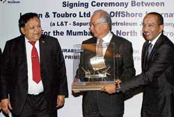 L&T CMD A M Naik (left) with Malaysian Prime Minister Mohd Najib Tun Abdul Razak (centre) during an MoU signing ceremony in Chennai on Friday. PTI