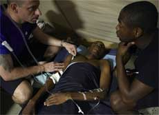 Wismond Exantus, rescued by a French search and rescue team after being trapped in rubble for 11 days in the aftermath of the massive earthquake, lies in a French military hospital in Port-au-Prince, Haiti on Saturday. AP