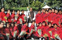 Madhya Pradesh chief minister Shivraj Singh Chouhan pose for a group photograph with Indian women hockey team after announcing Rs One crore financial assistance to the team, in Bhopal on Sunday. PTI