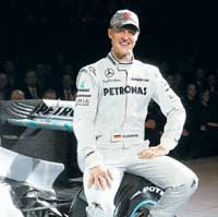 Back in the hunt: A relaxed Michael Schumacher can't wait to launch his comeback to F-1 with Mercedes GP. AP