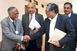 NLSIU Vice-Chancellor Dr Venkat Rao greeting former Chief Justice of India Justice Rajendra Babu at a function in  Bangalore on Monday. dh photo