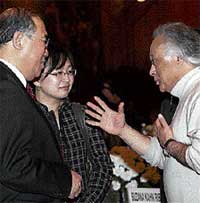 Environment Minister Jairam Ramesh talks with Vice Chairman, National Development and Reform Commission of China, Xie Zhenhua, in New Delhi on Sunday. PTI